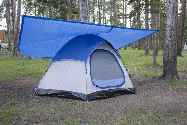 tent with tarp over it in rain