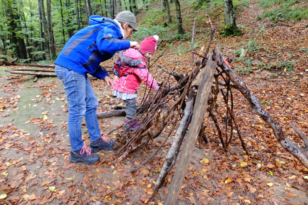 making a survival shelter while camping