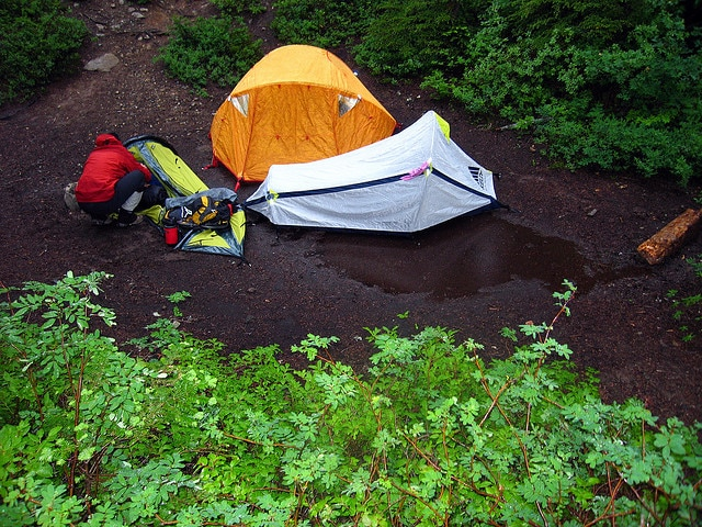 tents in rain puddle