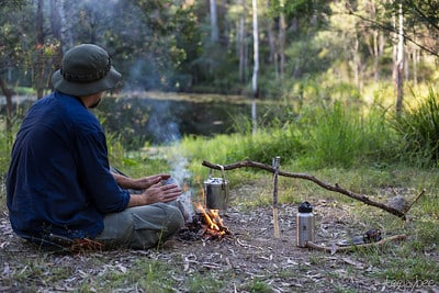 cooking over campfire with crane