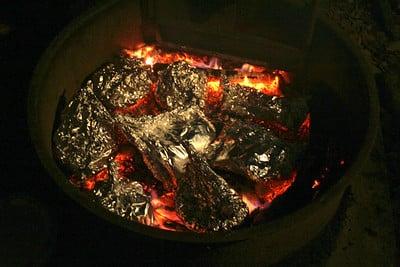 foil pouches over campfire coals