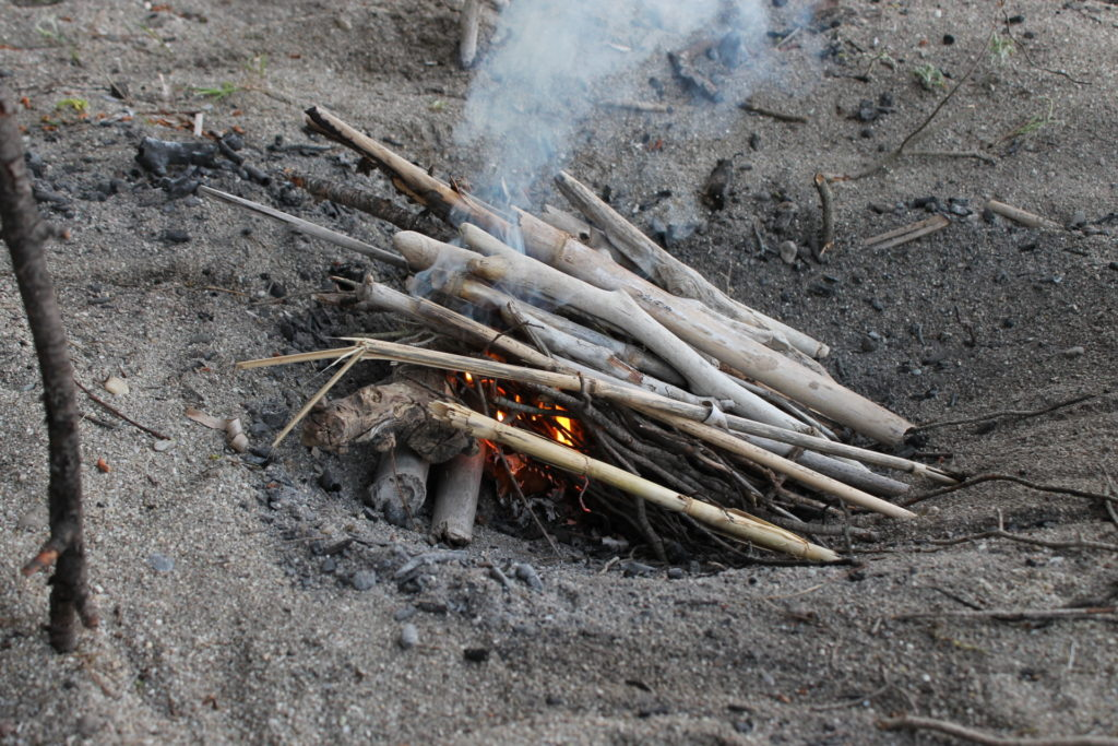 The lean-to fire lay keeps the tinder and lower-levels of kindling dry.