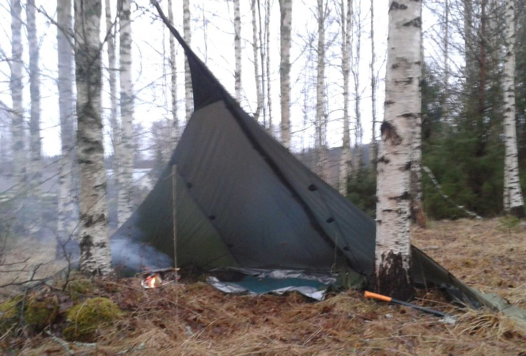 Make your fire at the mouth of the loue tent to keep the rain out of it.