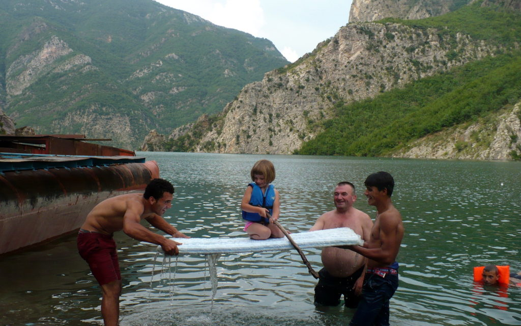 Isabel playing with the Albanian locals at Koman before taking a boat to our camping spot