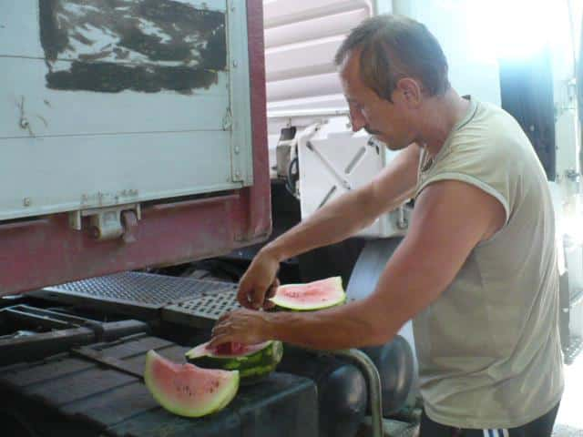 I hitchhiked a ride from this nice guy in Ukraine with a truck full of watermelon. We stopped to eat one on the way.