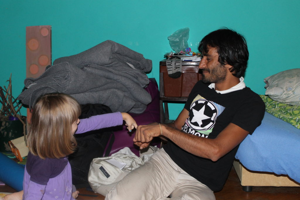 Isabel playing with a refugee from Afghanistan whom we hosted.