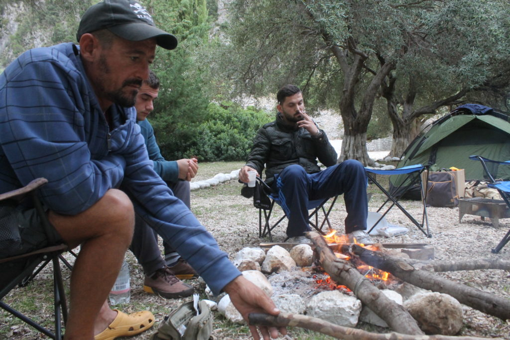 Hanging out around the fire with camping neighbors