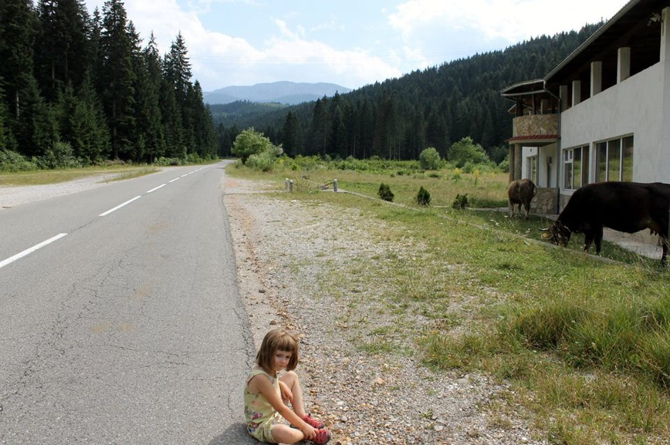 Isabel and me waiting while absolutely no cars go by.