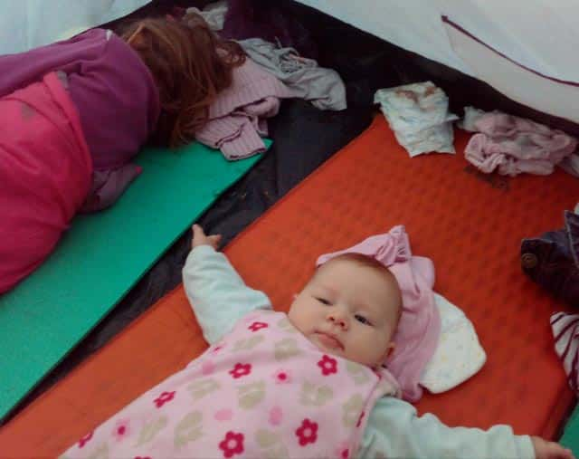 baby in tent on sleeping pad