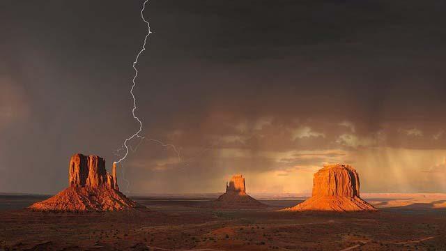 lightning striking in desert