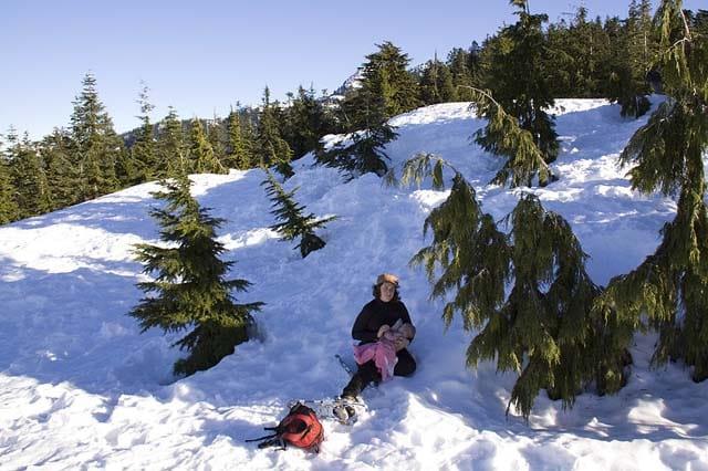 breastfeeding on winter hike in snow