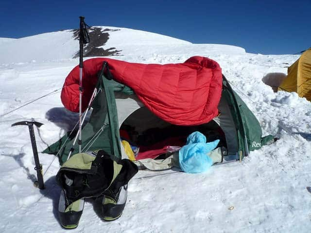drying sleeping bag over tent in winter