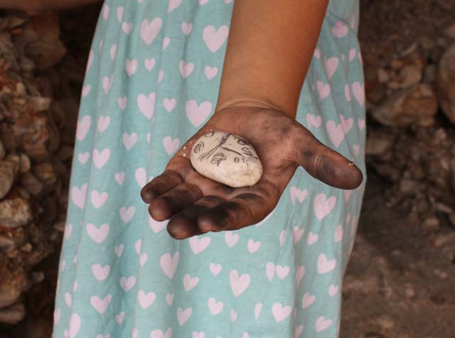 camping activity for kids drawing with charcoal from fire