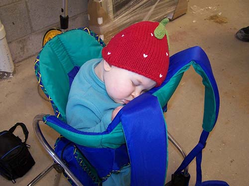 baby sleeping in her hiking carrier at home while testing gear